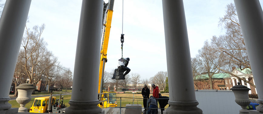 Thinker being removed via crane