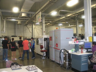 photo of Arcam equipment with tour group in background