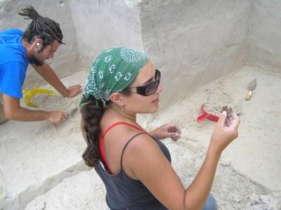 female in field doing research