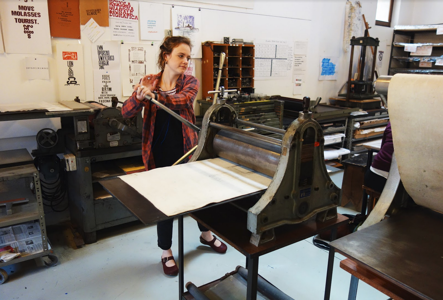 Printmaking student, Cassidy in the print shop.