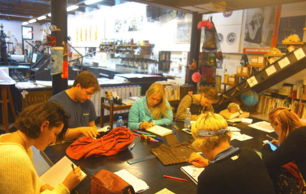 Students printmaking in Italy