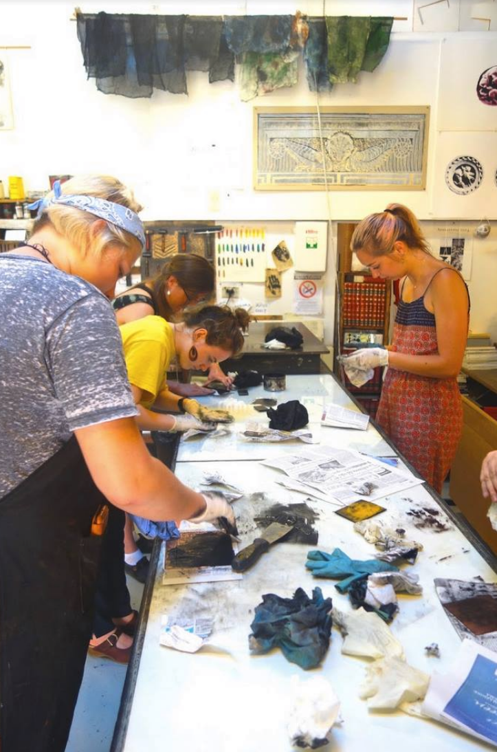 Hite students inking plates in Italy.