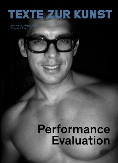 Texte zur Kunst: performance evaluation. Photograph of a shirtless man smiling.
