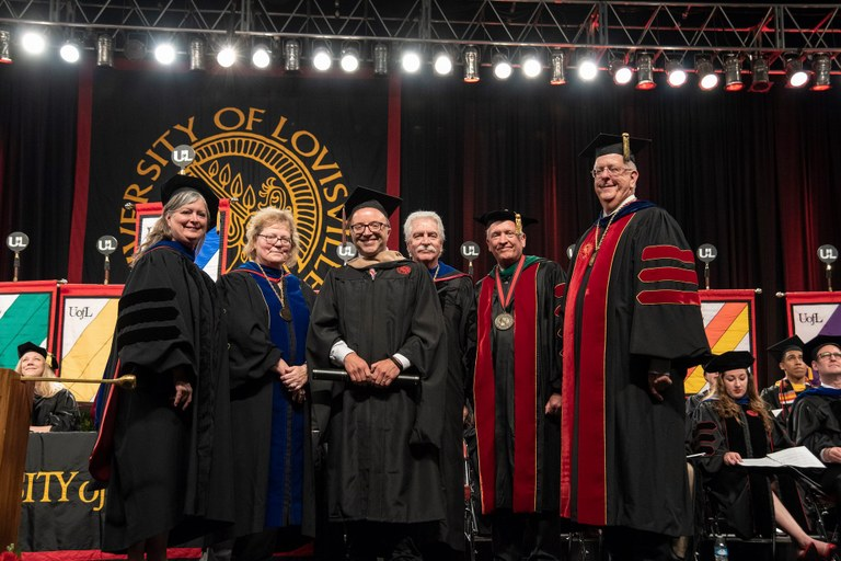 A&S Dean Kimberly Kempf-Leonard, SIGS Dean Beth Boehm, Douglas Miller and his mentor Professor James Grubola, Interim President Greg Postel, and Acting University Provost Dale Billingsley at the Hooding Ceremony
