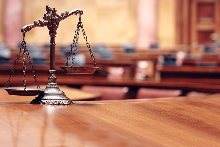 Scales of justice in a court room