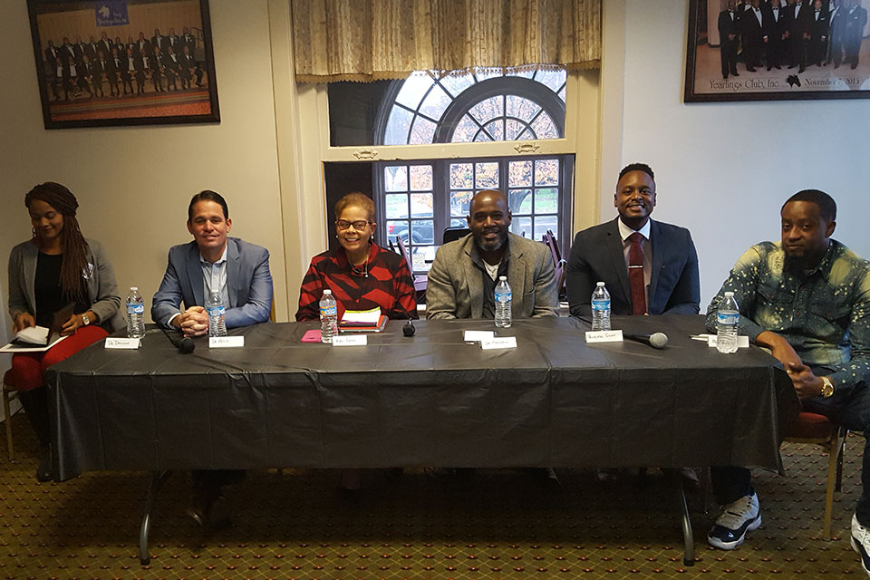 Seated left to right: Dr. Marty Pollio, JCPS Interim Superintendent, Mrs. Diane Porter, JCPS Board of Education; Dr. John Marshall, Chief Equity Officer, Robert Gunn, Principal, W. E. B. DuBois Academy; Camara Douglas, Doctoral Student – Dept. of Pan African Studies.
