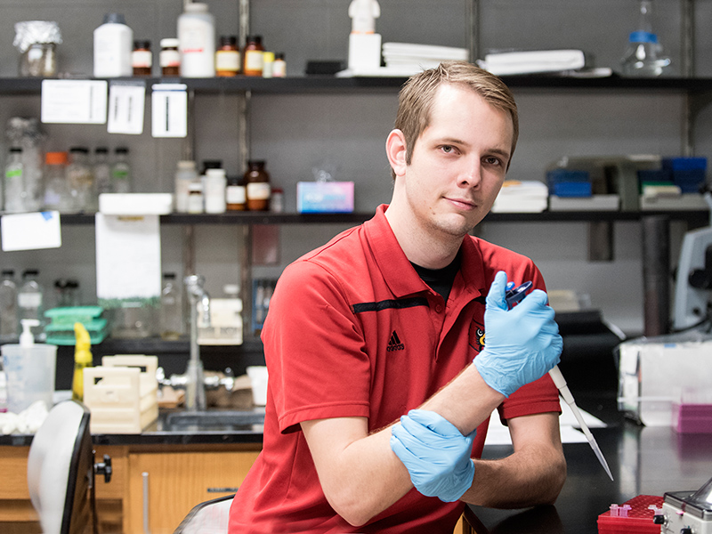 male student works in lab