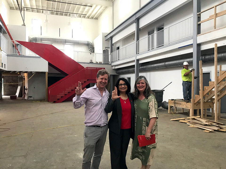Gill Holland and UofL President Neeli Bendapudi touring the facility with A&S Dean Kimberly Leonard, August 2018