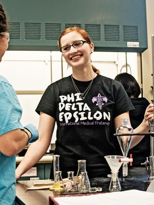 Chemistry major Carmela Riposo leads an Organic Chemistry lab.
