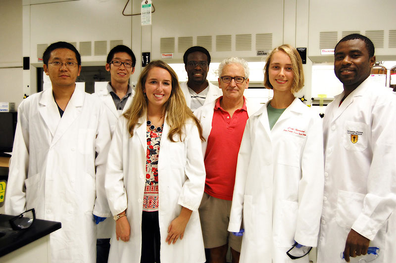 Chemistry graduate students in white lab coats