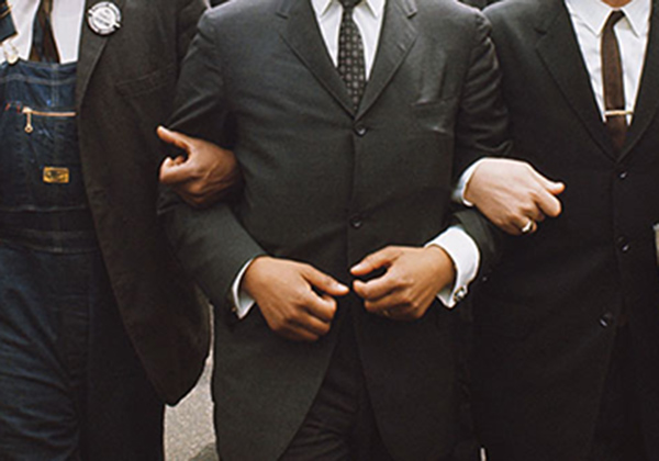 African American Men arms linked together