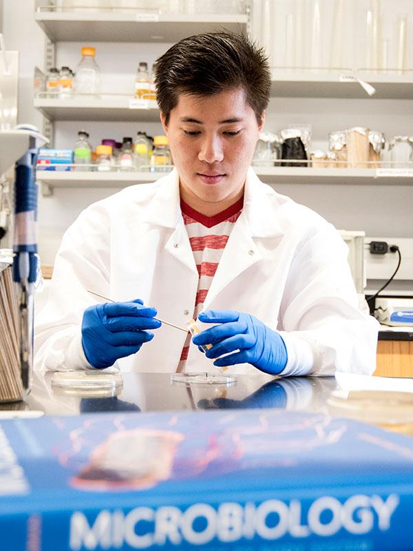 Steve Tran in lab coat