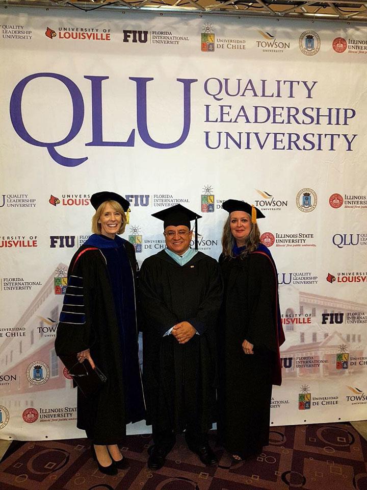 Oscar Leon, President, Quality Leadership University (QLU) and Jan Murphy, Interim Provost, Illinois State University with A&S; Dean Leonard at the 2017 graduation.