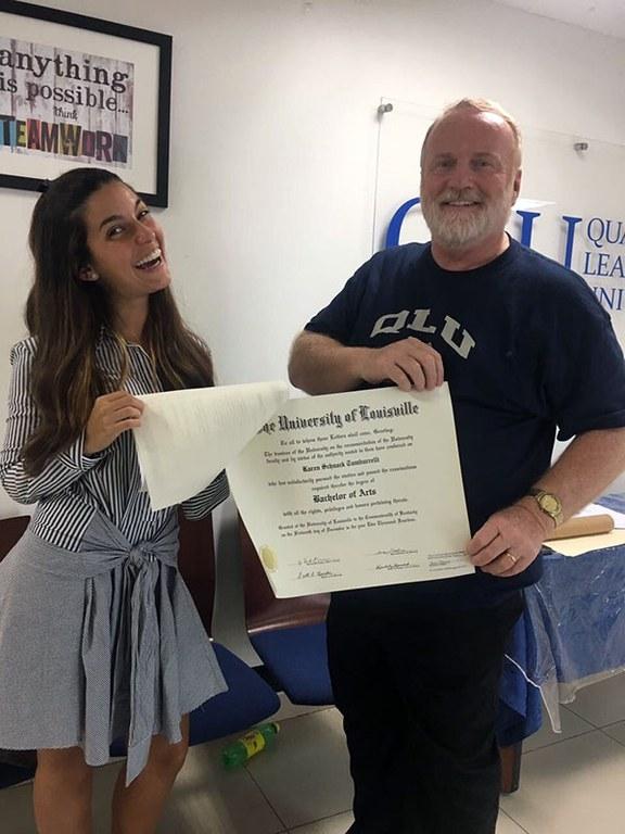 Prof. Futrell (Communication) gives student Karen Schnack her diploma.