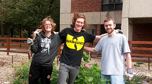 Graduate student volunteer garden tenders. Notice how weeding makes them smile. Thanksy'all, you were the best!   Left to Right:  Lindsay Nason, Nik Short and Matt Reid.