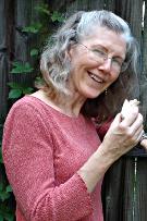Dr. Mansfield-Jones holding a vertebra.