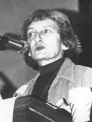 Anne Braden speaking at a podium
