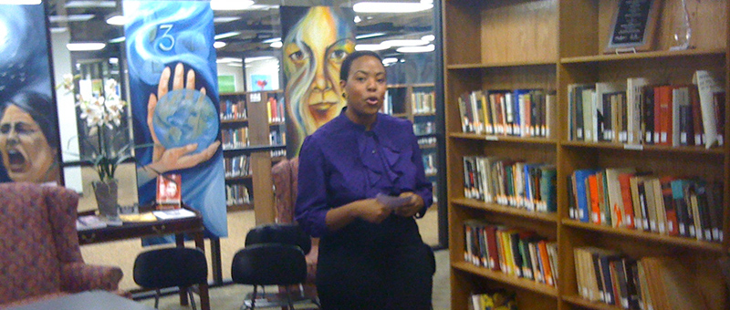 African American woman speaking in library