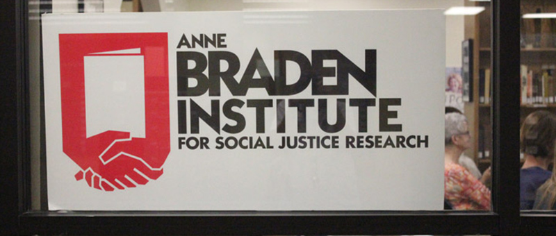 sign on window hands claspt Anne Braden Institute for Social Justice Research