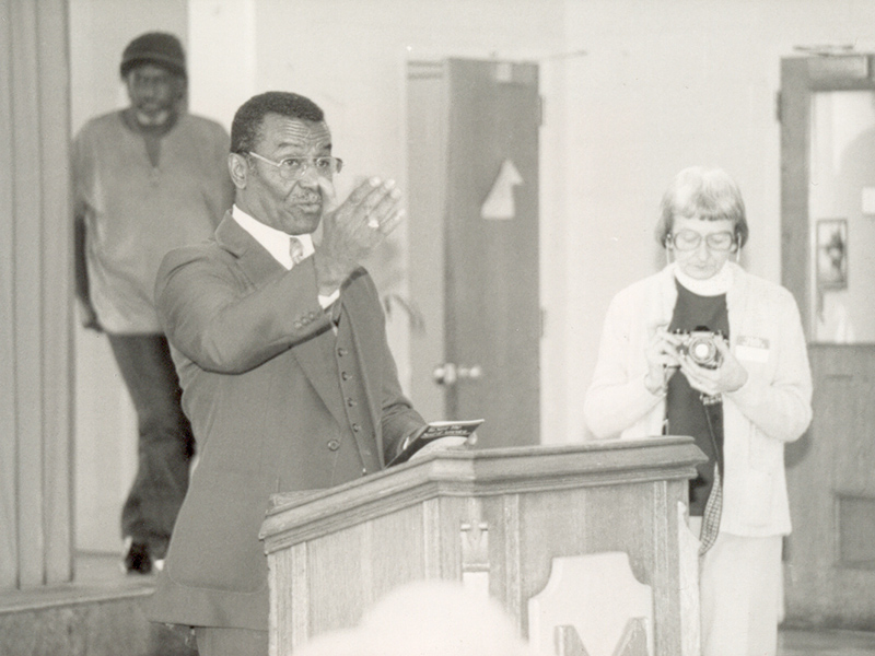 Anne Braden and an African American man speaking to crowd
