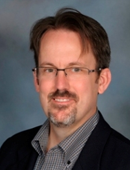 Portrait of Michael Merchant, PhD