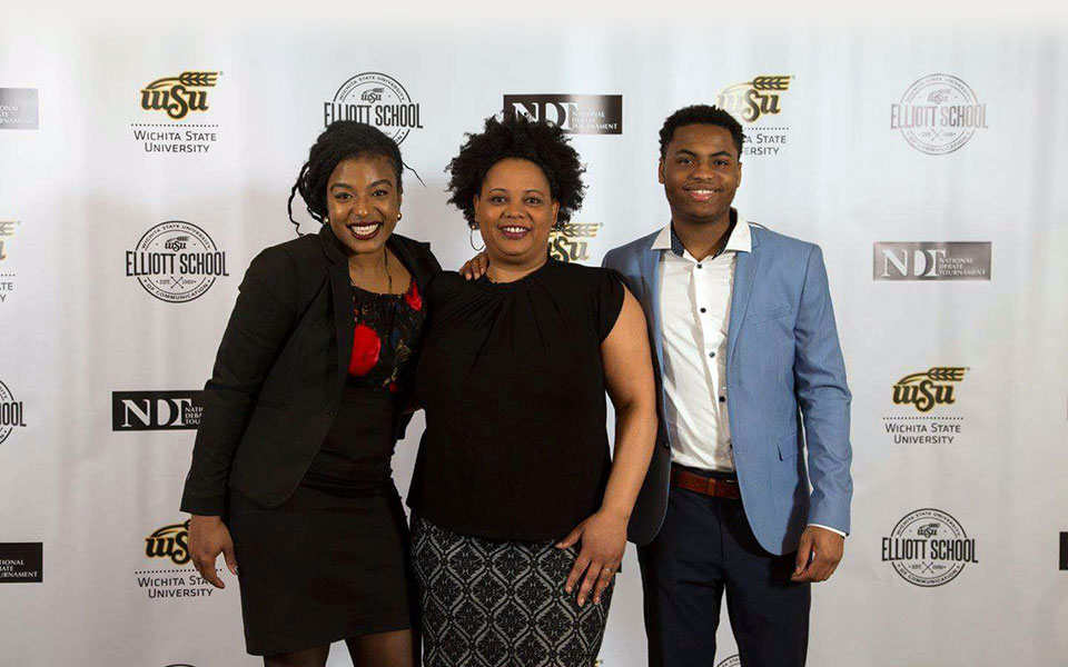 Tiffany Dillard-Knox and two other people posing at an event