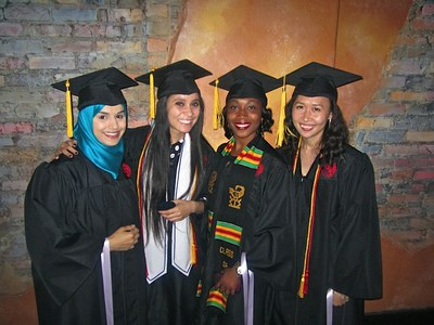 Image of hygiene students in cap and gown - University of Louisville School of Dentistry