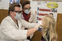 Children receive free dental screenings and oral health education