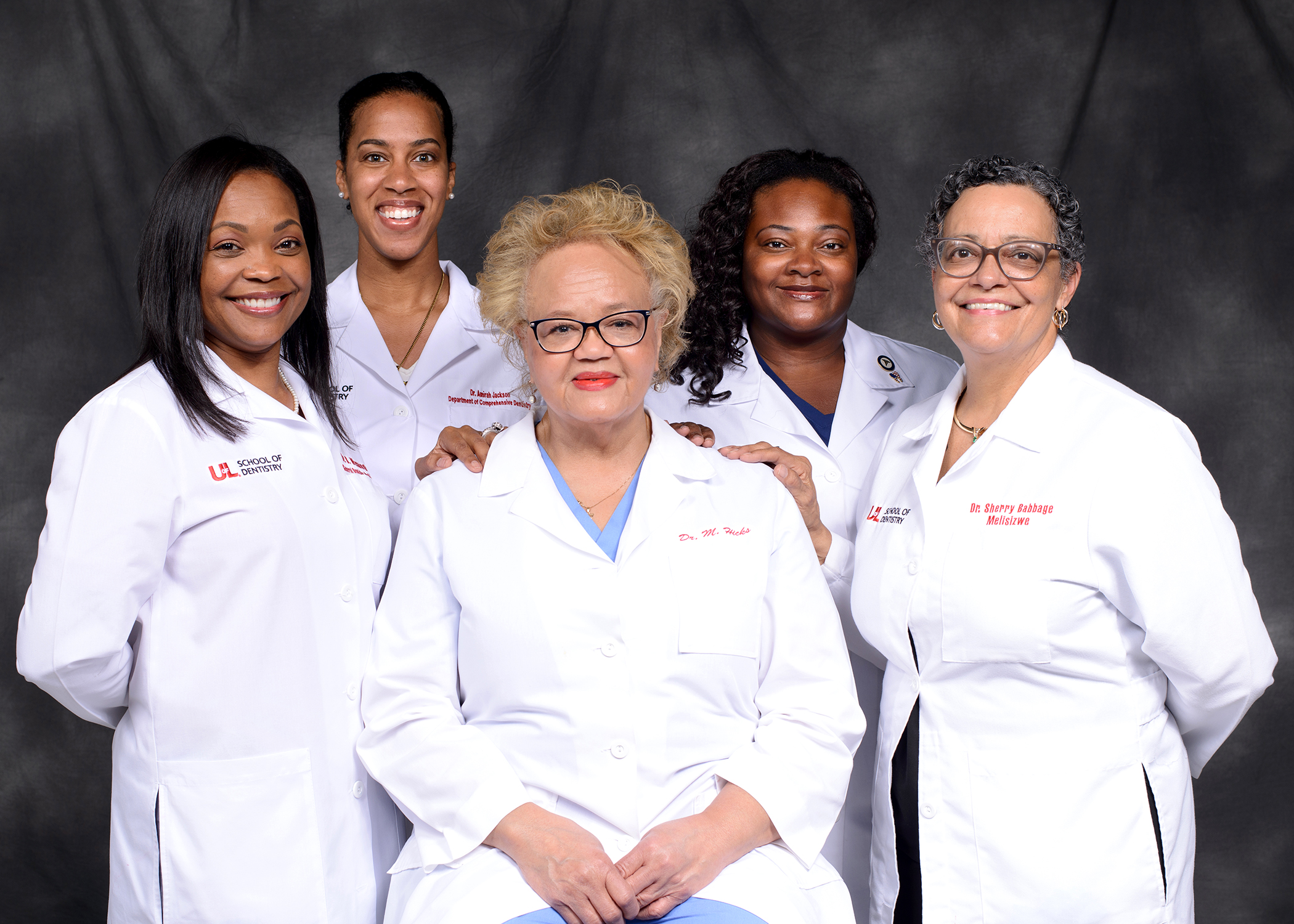 Dr. Madeline Hicks (seated) with Dr. Breacya Washington, Dr. Amirah Jackson, Dr. Tiffany McPheeters and Dr. Sherry Babbage (standing L-R).