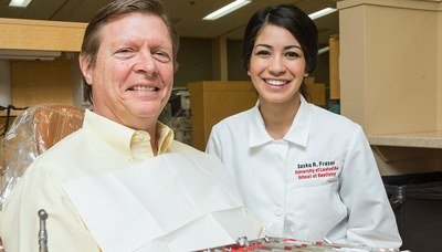 Image of patient and faculty at the University of Louisville School of Dentistry