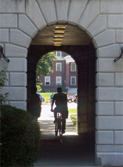 A bicyclist riding through a tunnel