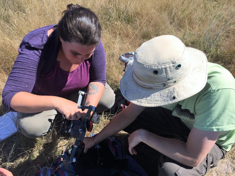 Ariel Weaver and Dr. Forrest Stevens prepare a UAS for flight operations in Africa