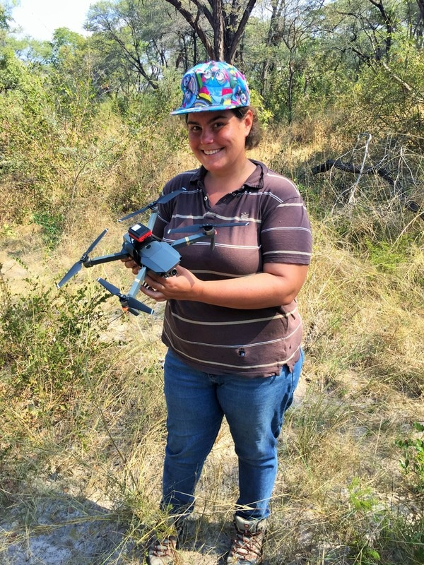 Ariel Weaver holds a imaging drone in the field during her recent Fulbright experience in Southern Africa.