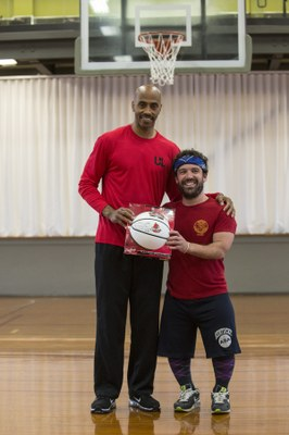 Darrell Griffith poses with winner of Signed Baksetball
