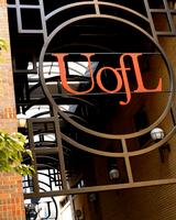 U of L in decorative metal work over a walkway