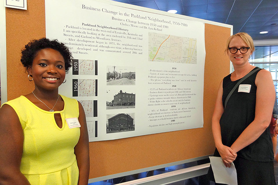History major Chelsea Moore presents on her history of the Parkland Neighborhood Business District, research supported by Dr. Lara Kelland