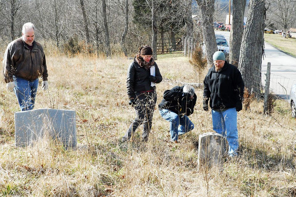 Students recording information from gravestones at a cemetery historically associated with an African American church outside of Sadieville, KY. Shown in the photo are Scott Weinhusesn, Nicole Cissell, and Andrew Clark.