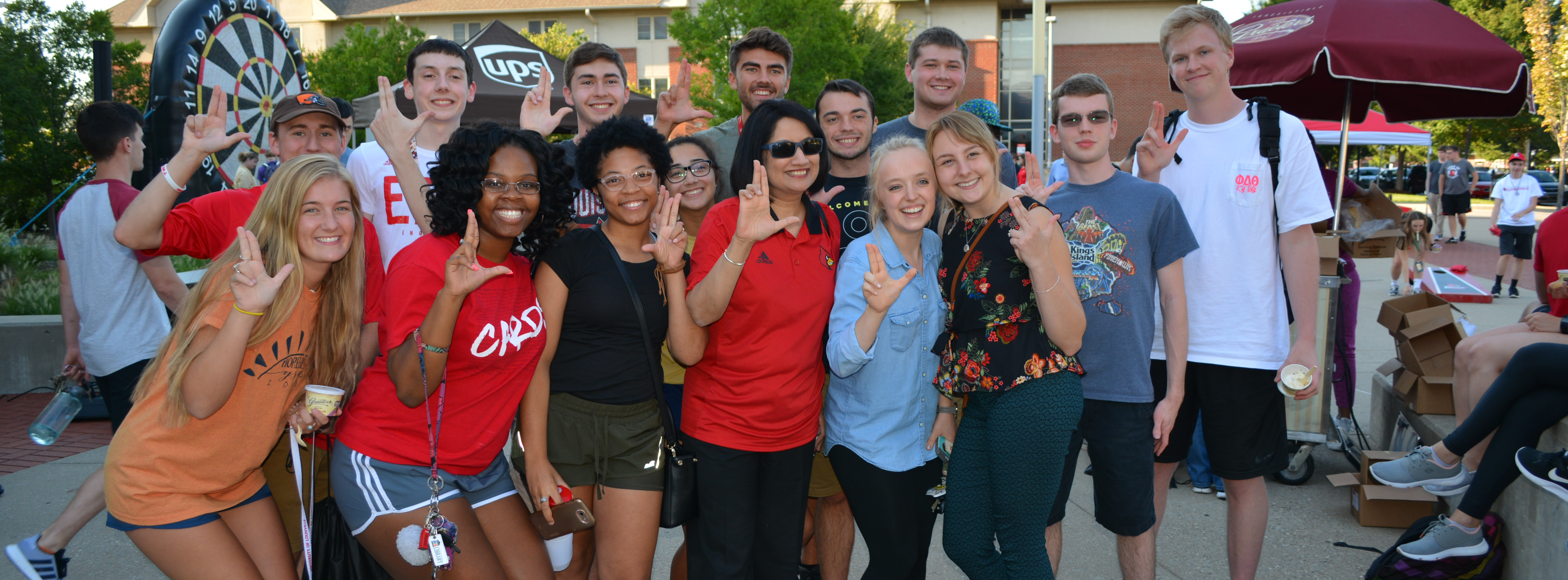 Photo of students with President Neeli Bendapudi