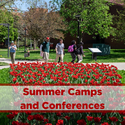 photo of students on campus during the summer with red flowers. Click to view summer camps and conferences housing information