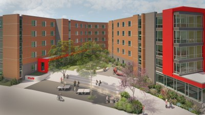 exterior of new residence hall 2020 with a courtyard in the front where students are sitting