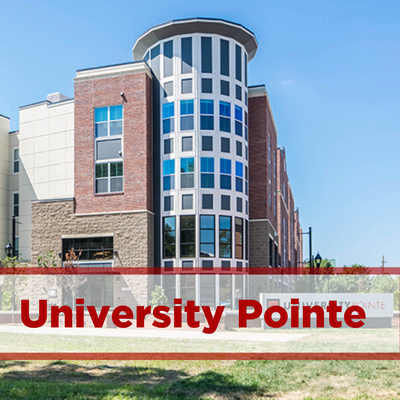 exterior of university pointe. windows with brick facade.