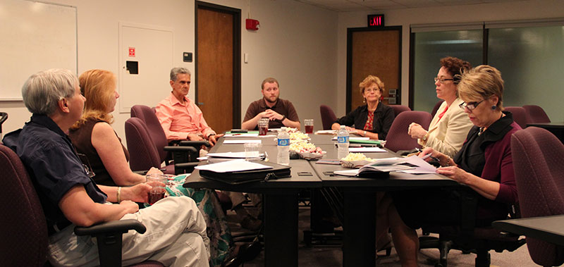 Photo of the Fifth Year Interim Report Committee having a meeting