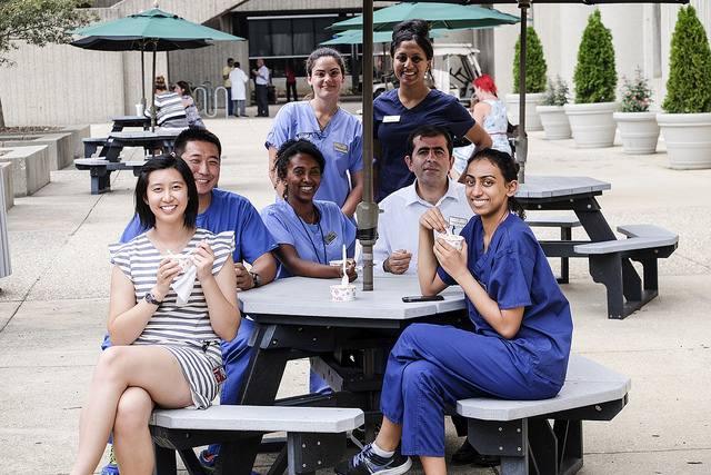 A group of international students enjoying a snack outside on the Health Sciences Campus.