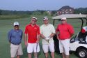 picture of four golfers