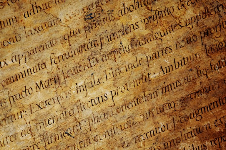 Antique Greek and Latin text on an old parchment