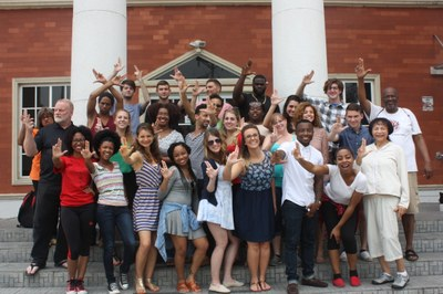 group of student pose with L sign