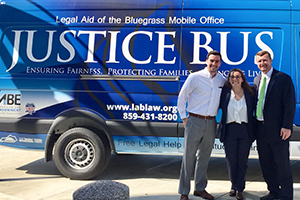 From left, Dominic Donovan, Caitlin Kidd and Joshua Fain with Legal Aid of the Bluegrass' Justice Bus.