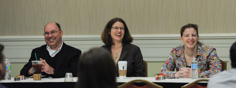 Photograph of professors Tony Arnold, Jamie Abrams and JoAnne Sweeny speaking as panelists at the National Conference of Law Reviews.