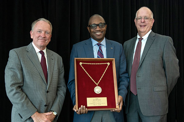 From left, Interim President Greg Postel, Professor Cedric Merlin Powell and Interim Provost Dale Billingsley