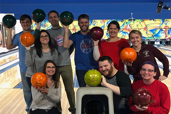 Professor Justin Walker and research assistants go bowling.
